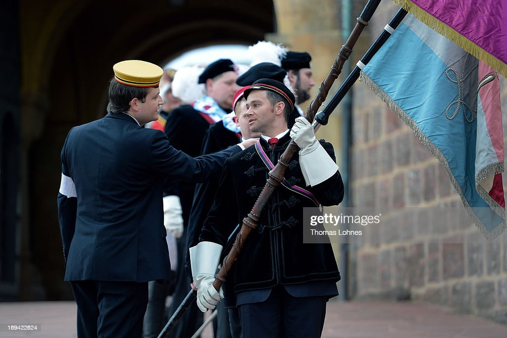 Members of German traditional university fraternities, in German called Burschenschaften, practice before a ceremony at the Wartburg castle on May 24, 2013 in Eisenach, Germany. The Burschenschaftenm, who are holding thier annual meeting in Eisenach, originated in 1815 among university students who volunteered to fight Napoleon.
