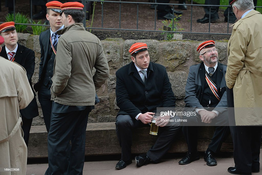 Members of German traditional university fraternities, in German called Burschenschaften, wait for a ceremony at the Wartburg castle on May 24, 2013 in Eisenach, Germany. The Burschenschaftenm, who are holding thier annual meeting in Eisenach, originated in 1815 among university students who volunteered to fight Napoleon.