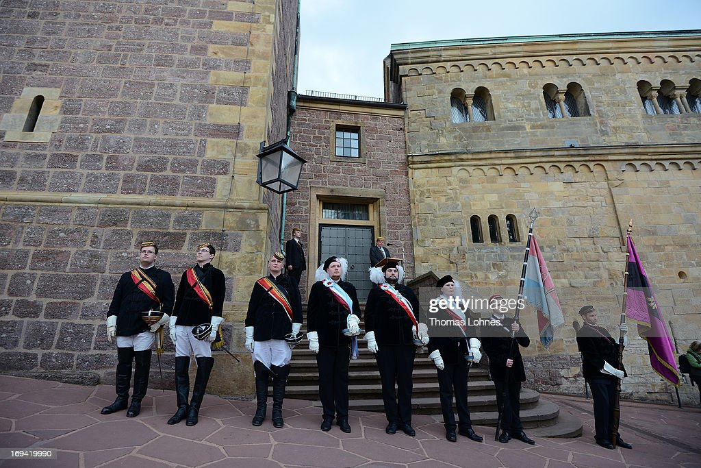 Members of German traditional university fraternities, in German called Burschenschaften, stand during ceremony at the Wartburg castle on May 24, 2013 in Eisenach, Germany. The Burschenschaftenm, who are holding thier annual meeting in Eisenach, originated in 1815 among university students who volunteered to fight Napoleon.