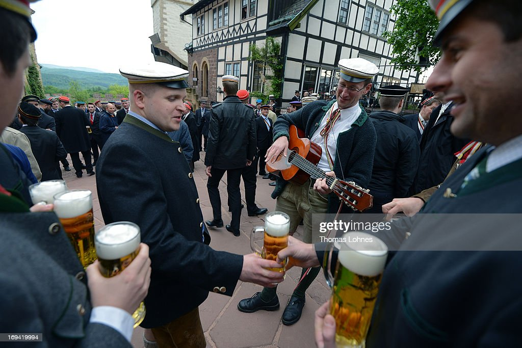 Members of German traditional university fraternities, in German called Burschenschaften, sing and drink beer before a ceremony at the Wartburg castle on May 24, 2013 in Eisenach, Germany. The Burschenschaftenm, who are holding thier annual meeting in Eisenach, originated in 1815 among university students who volunteered to fight Napoleon.