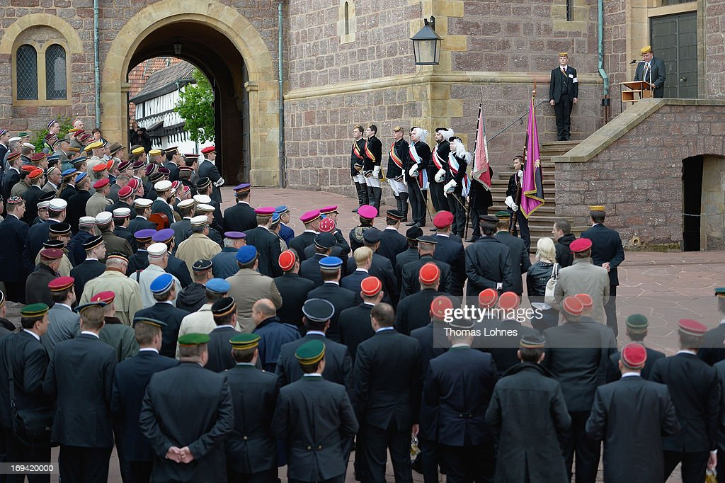 Members of German traditional university fraternities, in German called Burschenschaften, stand during the ceremony at Wartburg castle on May 24, 2013 in Eisenach, Germany. The Burschenschaftenm, who are holding thier annual meeting in Eisenach, originated in 1815 among university students who volunteered to fight Napoleon.