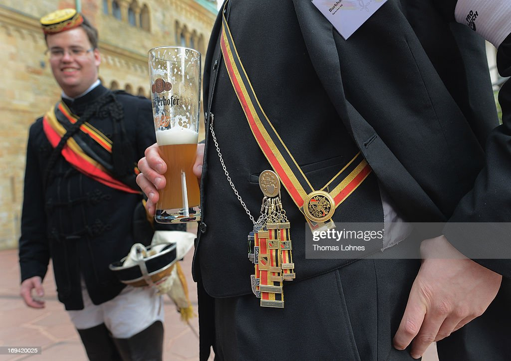 Members of German traditional university fraternities, in German called Burschenschaften, drink beer before a ceremony at the Wartburg castle on May 24, 2013 in Eisenach, Germany. The Burschenschaftenm, who are holding thier annual meeting in Eisenach, originated in 1815 among university students who volunteered to fight Napoleon.