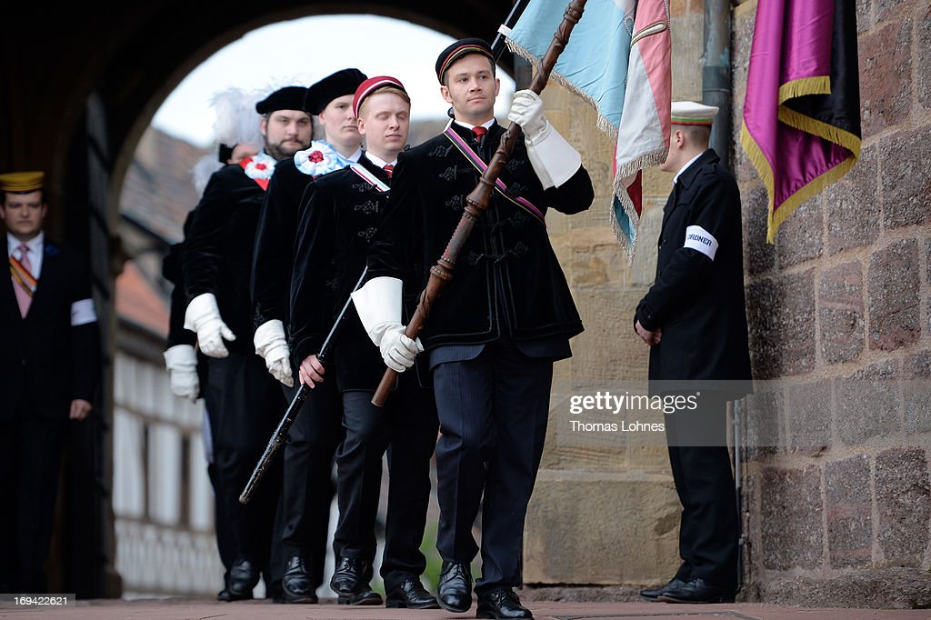 Members of German traditional university fraternities, in German called Burschenschaften, take part in a ceremony at the Wartburg castle on May 24, 2013 in Eisenach, Germany. The Burschenschaftenm, who are holding thier annual meeting in Eisenach, originated in 1815 among university students who volunteered to fight Napoleon.