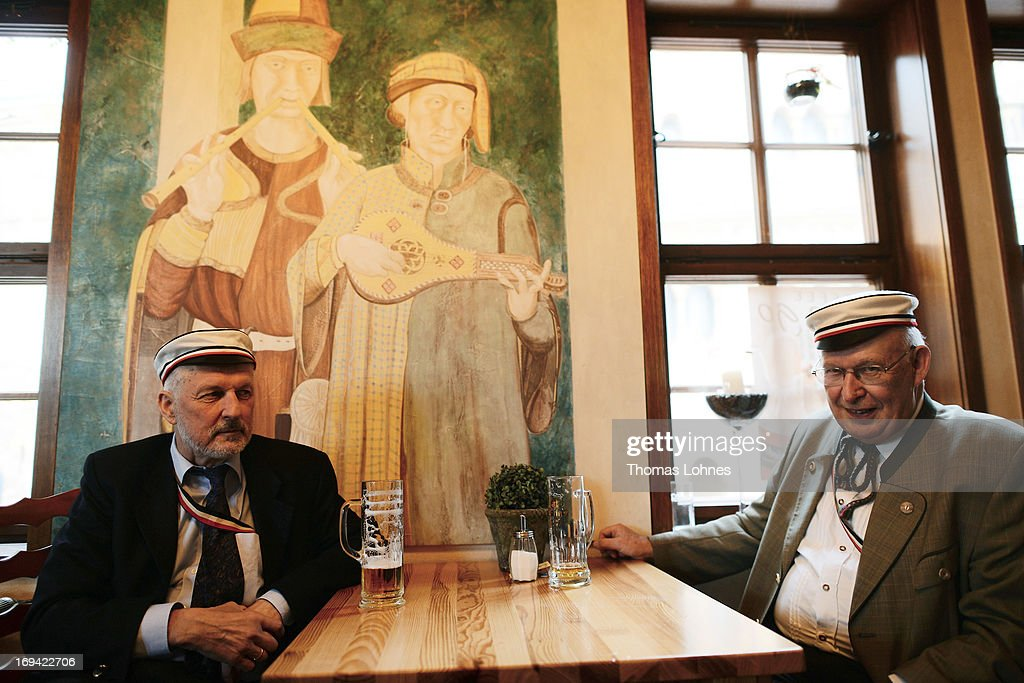 Members of German traditional university fraternities, in German called Burschenschaften, drink beer in a pub before a ceremony at the Wartburg castle on May 24, 2013 in Eisenach, Germany. The Burschenschaftenm, who are holding thier annual meeting in Eisenach, originated in 1815 among university students who volunteered to fight Napoleon.