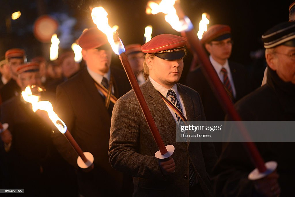 Members of German traditional university fraternities, in German called Burschenschaften, carry torches to the Burschenschaft Monument on May 24, 2013 in Eisenach, Germany. The Burschenschaftenm, who are holding thier annual meeting in Eisenach, originated in 1815 among university students who volunteered to fight Napoleon.
