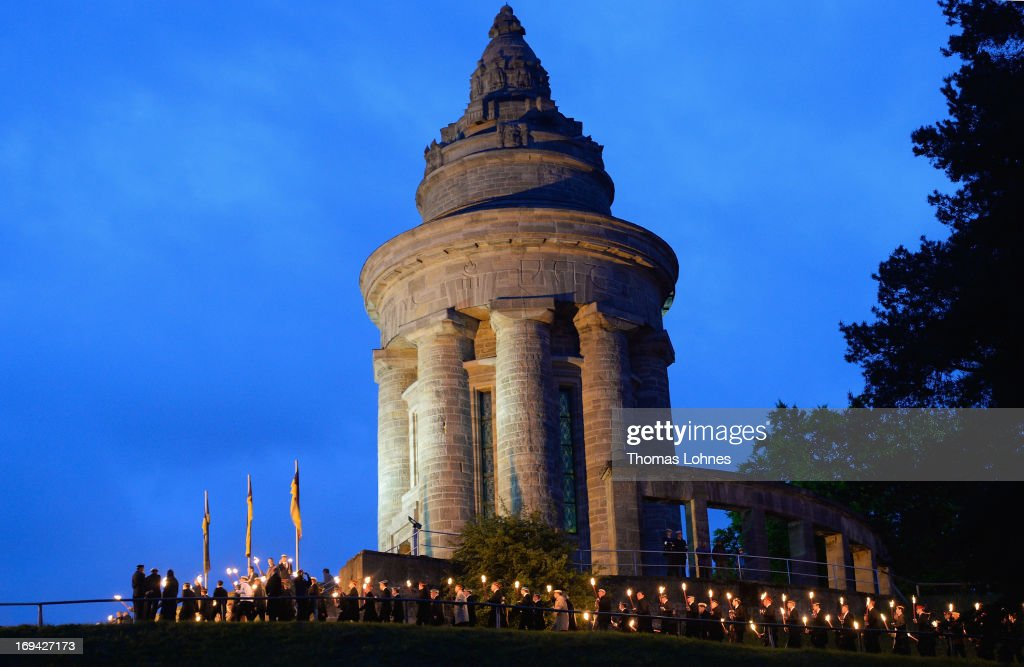 Members of German traditional university fraternities, in German called Burschenschaften, gather with torches at the Burschenschaft Monument on May 24, 2013 in Eisenach, Germany. The Burschenschaftenm, who are holding thier annual meeting in Eisenach, originated in 1815 among university students who volunteered to fight Napoleon.