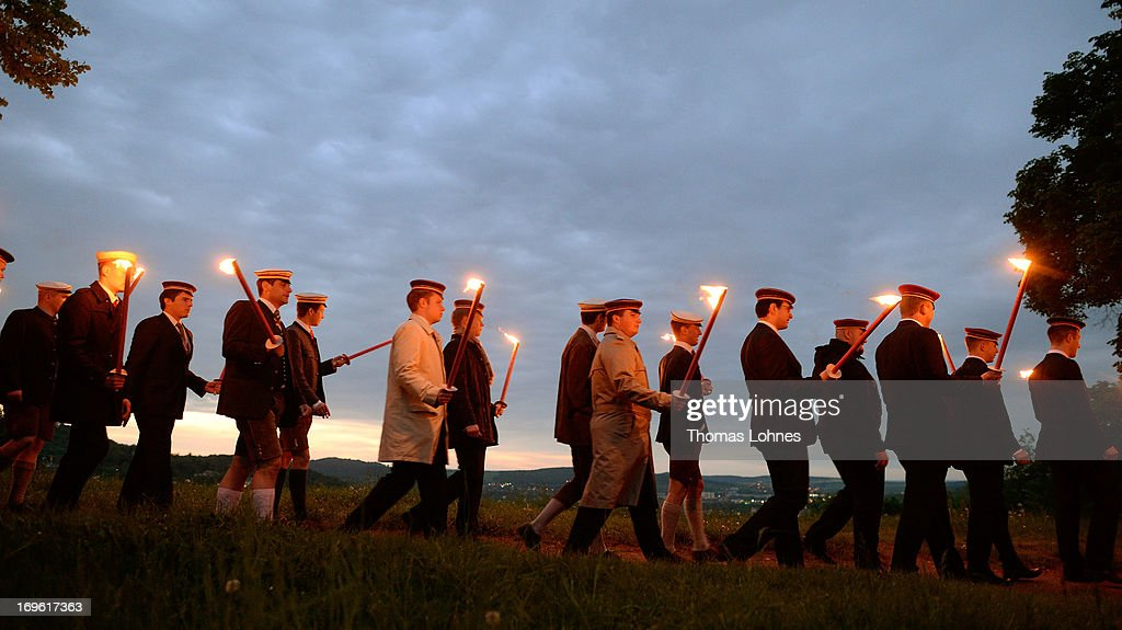 Members of German traditional university fraternities, in German called Burschenschaften, gather with torches to the Burschenschaft Monument on May 24, 2013 in Eisenach, Germany. The Burschenschaften are holding their annual meeting in Eisenach. The Burschenschaften originated in 1815 among university students who volunteered to fight Napoleon.