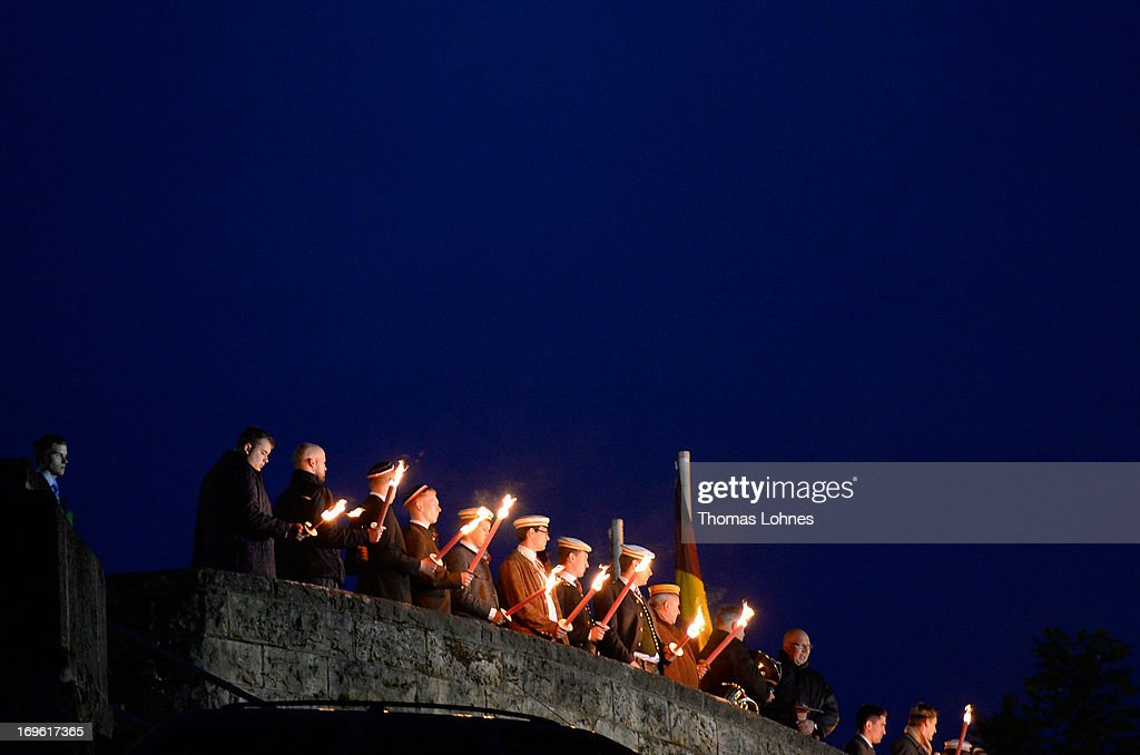 Members of German traditional university fraternities, in German called Burschenschaften, sings with torches the national anthem at the Burschenschaft Monument on May 24, 2013 in Eisenach, Germany. The Burschenschaften are holding their annual meeting in Eisenach. The Burschenschaften originated in 1815 among university students who volunteered to fight Napoleon.