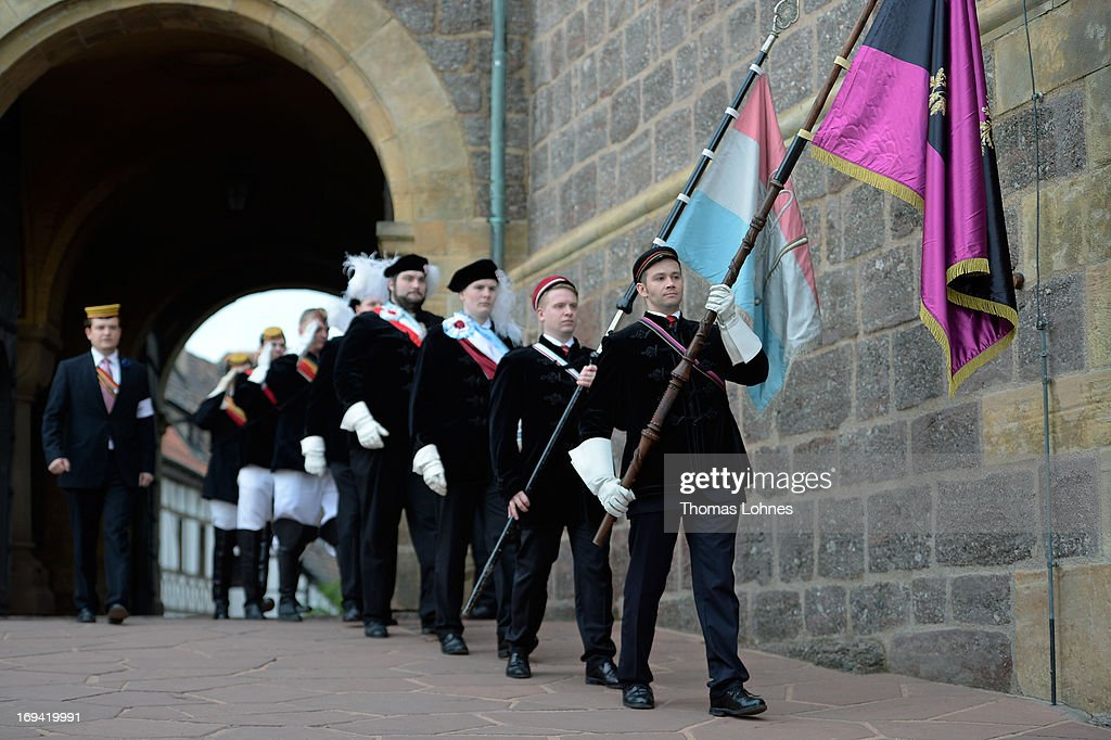 Members of German traditional university fraternities, in German called Burschenschaften, walk to a ceremony at the Wartburg castle on May 24, 2013 in Eisenach, Germany. The Burschenschaftenm, who are holding thier annual meeting in Eisenach, originated in 1815 among university students who volunteered to fight Napoleon.