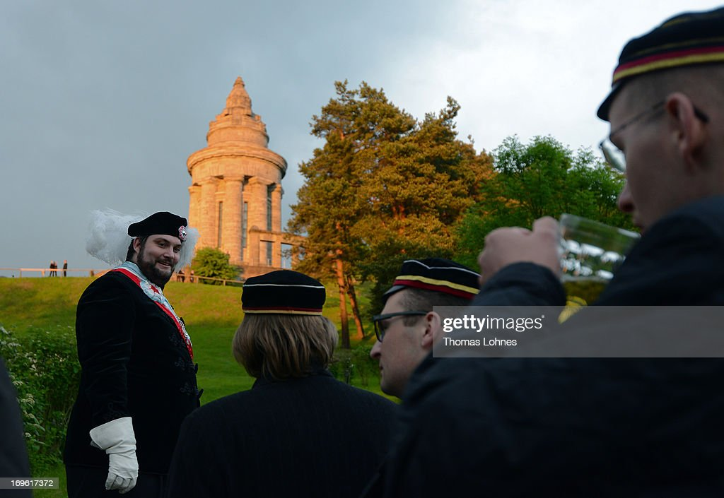 Members of German traditional university fraternities, in German called Burschenschaften, waits to for the torches ralley to the Burschenschaft Monument on May 24, 2013 in Eisenach, Germany. The Burschenschaften are holding their annual meeting in Eisenach. The Burschenschaften originated in 1815 among university students who volunteered to fight Napoleon.