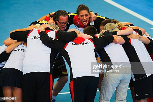 Members of Germany's Fed Cup team huddle together to celebrate their victory following the Fed Cup semifinal tie tennis match between Australia and...
