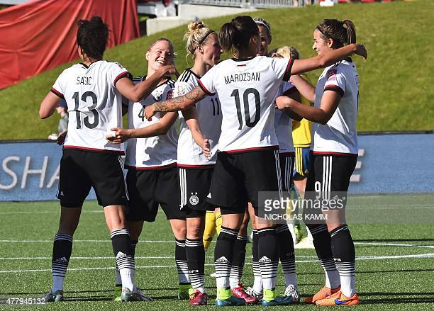 Members of Germany's national team celebrate their 41 victory over Sweden in a 2015 FIFA Women's World Cup round of 16 match at Lansdowne Stadium in...