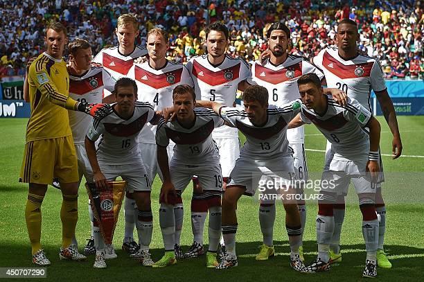 Members of Germany's national team Germany's goalkeeper Manuel Neuer Germany's midfielder Toni Kroos Germany's defender Per Mertesacker Germany's...