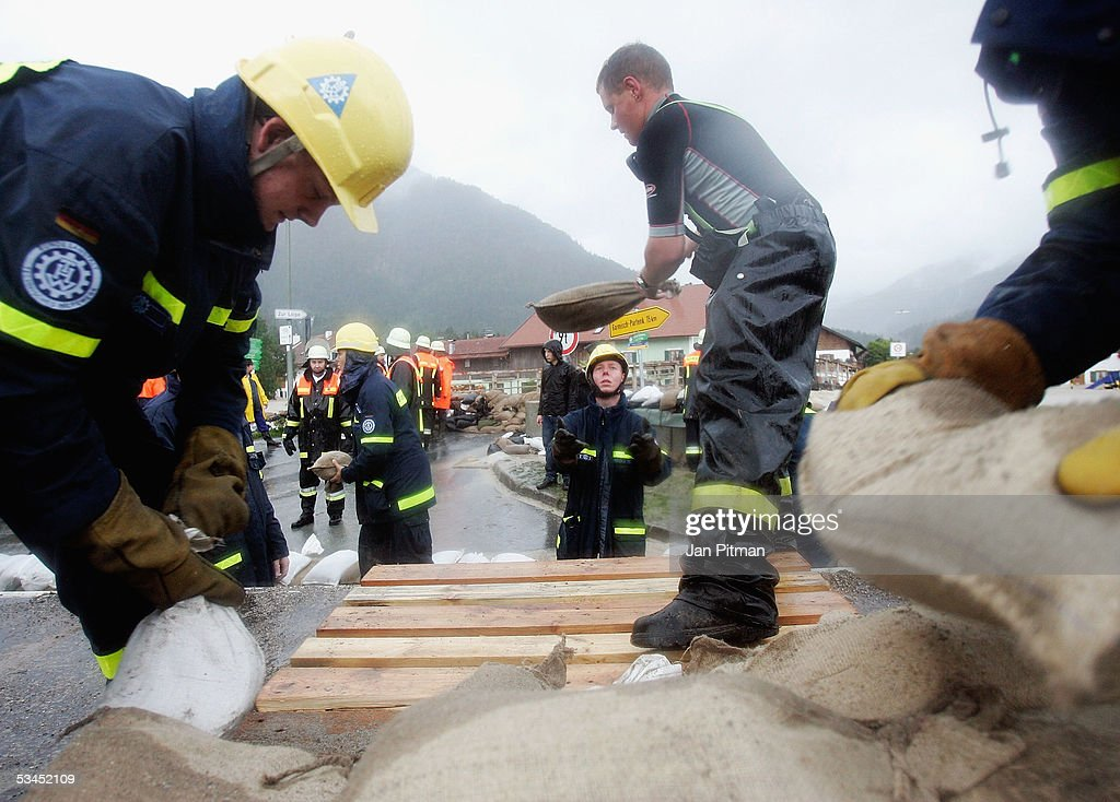 Members of Germany's THW (Technical Help Organization) build a barrier out of sandbags on a main street on August 23, 2005 in Eschenlohe, Germany. Heavy rainfall and floods in both Austria and Switzerland caused many of the rivers in southern Germany to flood. Half of Eschenlohe town has been evacuated and streets in the whole area are closed to traffic.