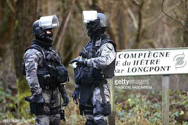 Members of GIPN are pictured in Corcy near VillersCotterets northeast of Paris on January 8 where the two armed suspects from the attack on French...