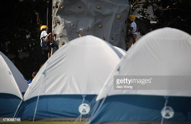 Members of Girl Scouts participate in rock climbing on the South Lawn during the firstever White House Campout June 30 2015 at the White House in...