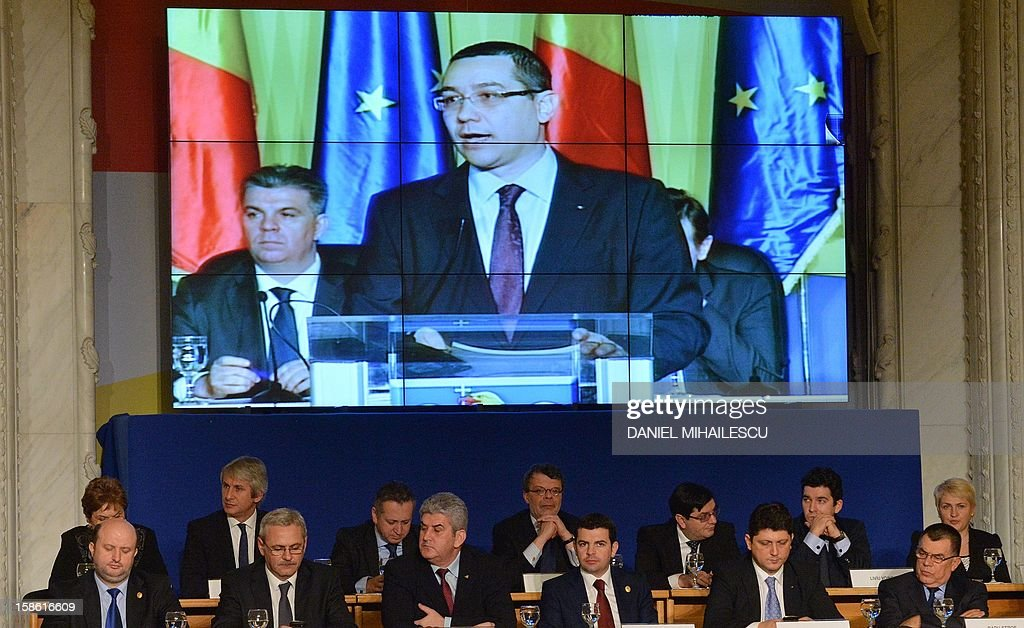 Members of government listen to the Romanian designated Prime Minister Victor Ponta as he adresses the Romanian Parliament in Bucharest, on December 21, 2012.The return of Victor Ponta as Romania's premier follows December 9 parliamentary elections, when his ruling centre-left Social-Liberal Union (USL) secured 60 percent of the vote.
