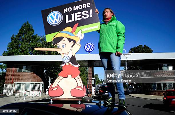 Members of Greenpeace protest outside the main gate at Volkswagen Headquarters on September 25 2015 in Wolfsburg Germany Matthias Mueller head of...