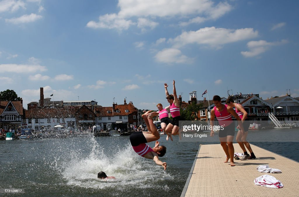 Members of Griffen Boat Club jump into the river in celebration after winning the final of the Thames Challenge Cup on finals day of the Henley Royal Regatta on July 7, 2013 in Henley-on-Thames, England.