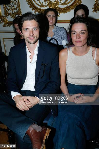 Members of group 'Something's Fishy' Raphael Personnaz and Audrey Ismael attend the Alexis Mabille show as part of Paris Fashion Week Haute Couture...