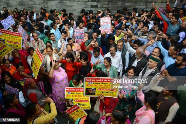 Members of Gudiya Nyay Manch stage a protest against rape and murder of teenage girl and forest guard Hoshiar Singh's murder outside the Himachal...