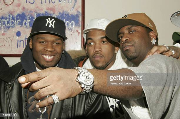 Members of GUnit rappers 50 Cent Lloyd Banks and Tony Yayo pose during the 2nd Annual Josh Evans/Book Bank Foundation Holiday Clothing Drive at the...