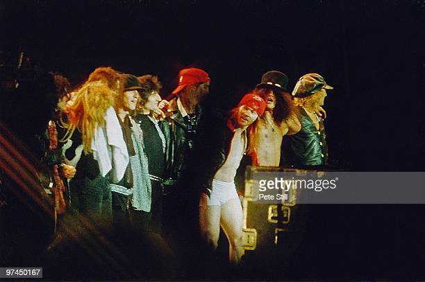 Members of Guns n' Roses including Axl Rose and Slash are joined by Rolling Stones guitarist Ronnie Wood while taking their final bow after...