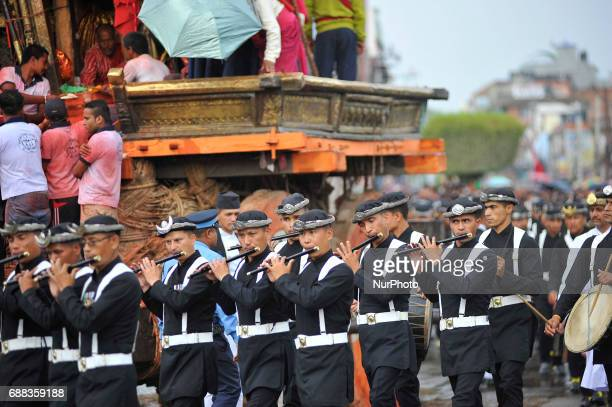 Members of Gurju Paltan Army personnel rotating Chariot by playing traditional musical instruments on celebration of Bhoto Jatra festival at...