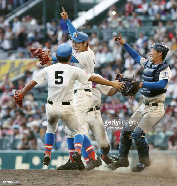 Members of Hanasaki Tokuharu celebrate after beating Koryo 144 in the final of the national high school baseball championship at Koshien Stadium in...