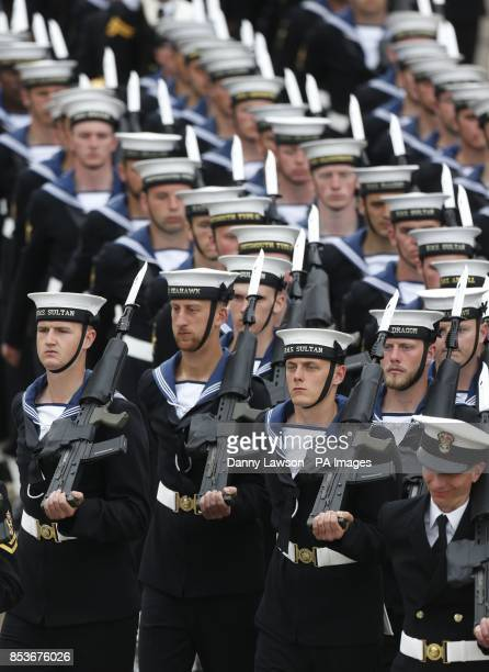 Members of he Royal Navy march as Queen Elizabeth II officially named Royal Navy's new aircraft carrier HMS Queen Elizabeth during a visit to Rosyth...