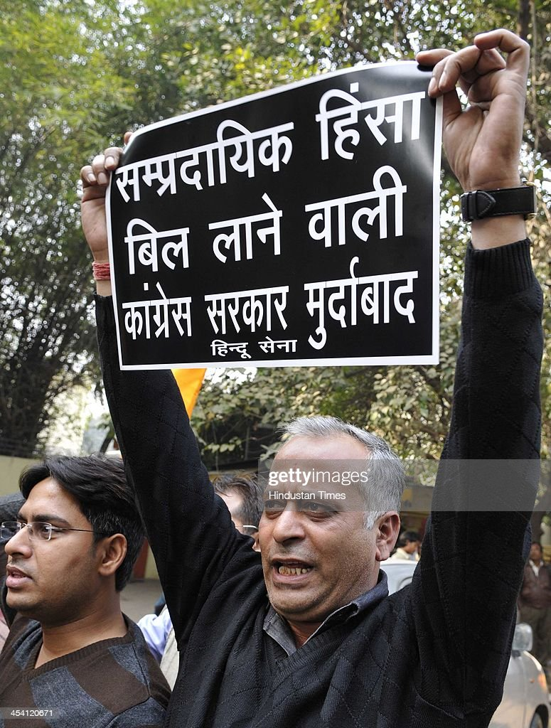 Members of Hindu Sena protest against communal violence bill as they burn copy of bill and portraits of Union Home Minister Sushil Kumar Shinde, UPA Chairperson Sonia Gandhi, and Minority Affairs Minister K Rahman Khan at Jantar Mantar on December 7, 2013 in New Delhi, India.