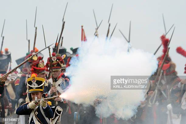 Members of historical clubs dressed as French soldiers and Russian soldiers take part in the reenactment of the 1812 battle between Napoleon's army...