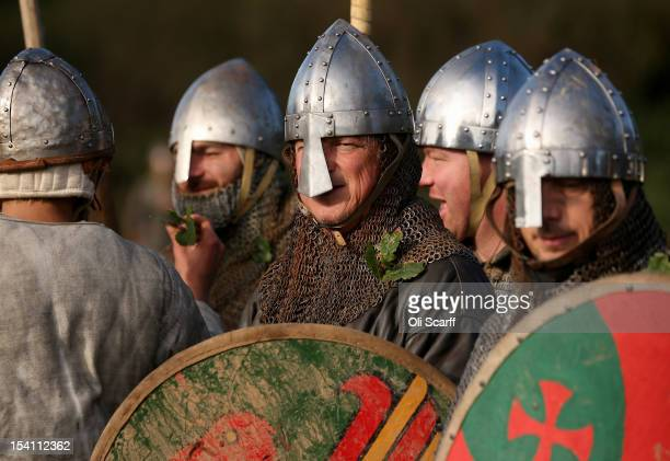 Members of historical reenactment groups attach oak leaves to their chainmail as a battle marking prior to the annual reenactment of the Battle of...
