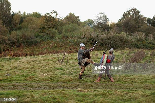 Members of historical reenactment groups practice their fighting before assuming the role of Norman soldiers in the annual reenactment of the Battle...
