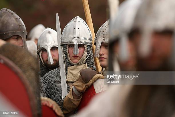 Members of historical reenactment groups prepare to assume the role of Norman soldiers in the annual reenactment of the Battle of Hastings at Battle...