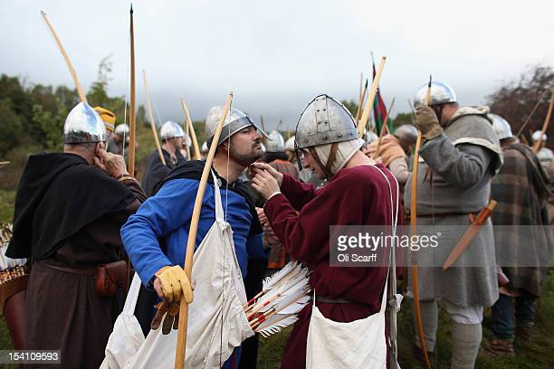 Members of historical reenactment groups prepare to assume the role of Norman archers in the annual reenactment of the Battle of Hastings at Battle...