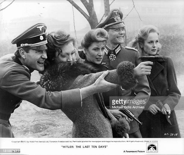 Members of Hitler's bunker Julian Glover Doris Kunstmann Amy Lynn Simon Ward and Sheila Gish out having target practice in a scene from the film...