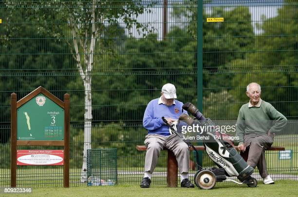 Members of Holywood Golf Club Holywood Golf Club in Co Down Northern Ireland the home club of US Open winner Rory McIlroy rest at the 3rd tee during...