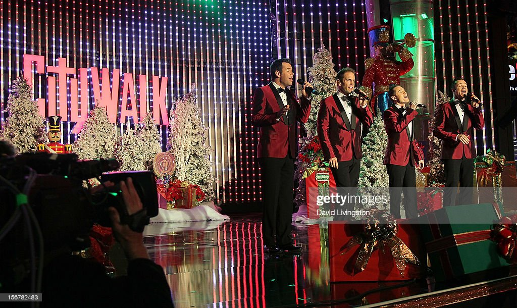 Members of Human Nature perform on stage at Associated Television International's 2012 Hollywood Christmas Parade Concert at Universal CityWalk's 5 Towers on November 20, 2012 in Universal City, California.