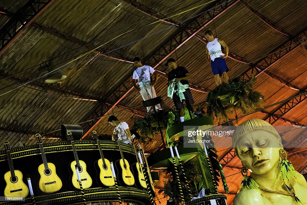 Members of Império Serrano samba school test the carry capacity of a carnival float inside the workshop in Rio de Janeiro, Brazil, 14 February 2012. The carnival preparations start early in July or August, some 7-8 months before the main samba schools parade at the sambodrome. Samba schools hire teams of professional designers and artists who, according to the original theme selected by the school directors and then featured by the school during the parade, create allegorical floats, costumes, sculptures, music, choreography and the entire school show. However, the most of the everyday work in the carnival hangars is performed by unknown but fully dedicated samba schools members.