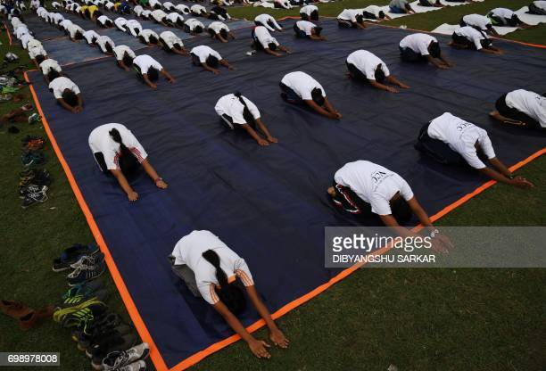TOPSHOT Members of India's National Cadet Corps take part in a mass yoga session to mark International Yoga Day on The Brigade Parade Grounds in...