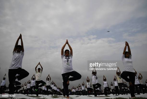 Members of India's National Cadet Corps take part in a mass yoga session to mark International Yoga Day on The Brigade Parade Grounds in Kolkata on...