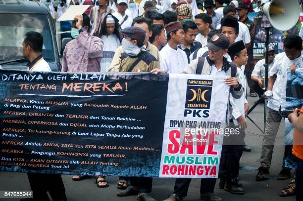 Members of Indonesian Islambased Prosperous Justice Party hold banners and shout slogans during a protest in Semarang Central Java Province Indonesia...