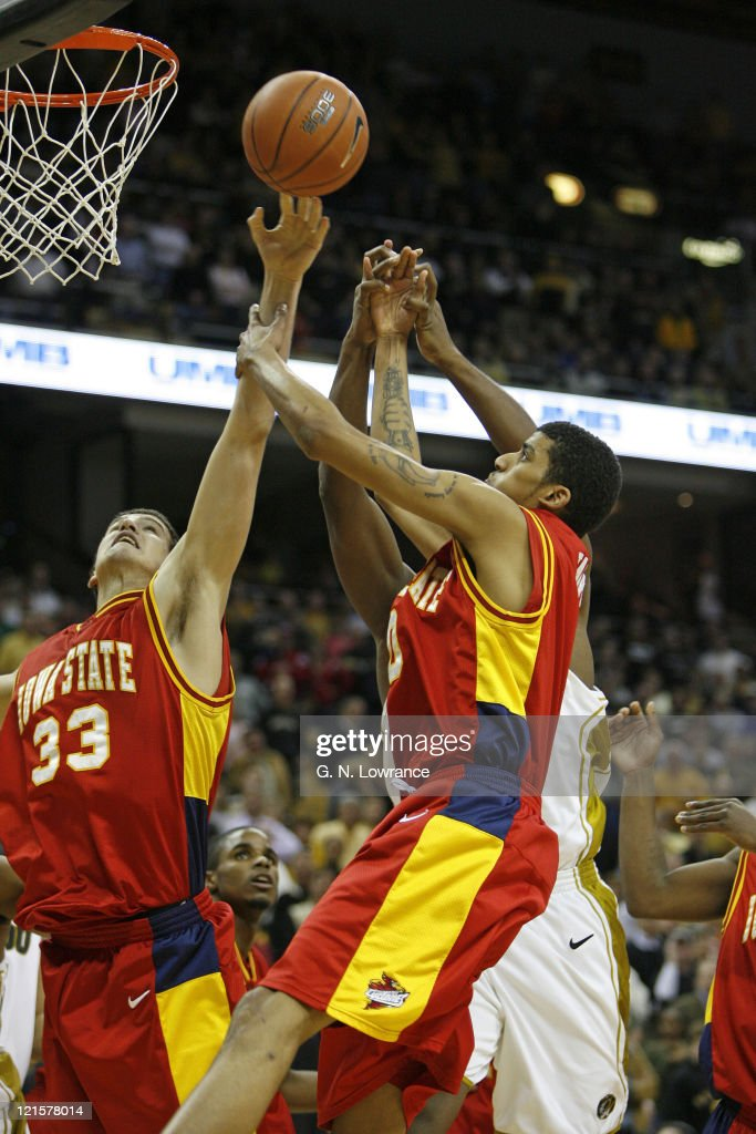 Members of Iowa State go up for a rebound during action against the the Missouri Tigers at Mizzou Arena in Columbia Missouri on January 25 2006 Iowa...