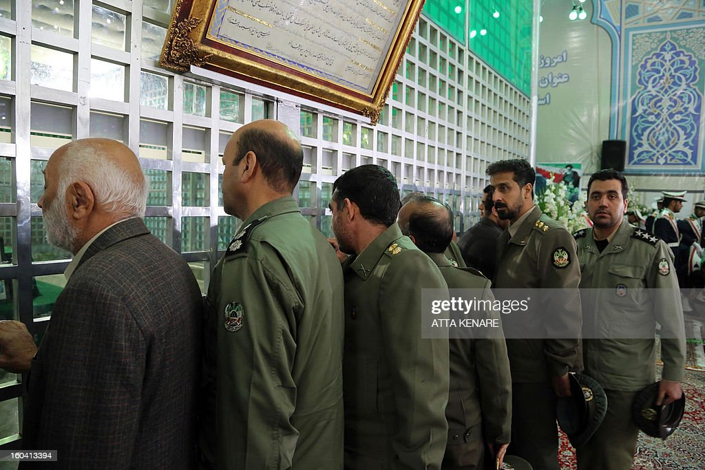 Members of Iranian Army visit the shrine of the founder of Iran's Islamic Republic, Ayatollah Ruhollah Khomeini during the 34th anniversary of his return from exile on January 31, 2013 at Khomeini's mausoleum in Tehran. Bells chimed across Iran to mark his return from exile in 1979, the trigger for a revolution which spawned an Islamic state now engulfed in a deep political crisis. AFP PHOTO/ATTA KENARE
