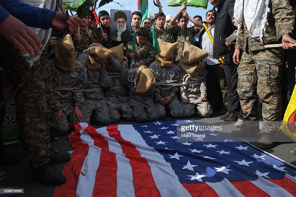 Members of Iranian Basij paramilitary force reenact the January capture of U.S sailors by the Revolutionary Guard in the Persian Gulf at a rally to mark the 37th anniversary of the Islamic revolution in Azadi Square (Freedom Square) on February 11, 2016 in Tehran, Iran. Rallies and celebrations are being held across the country. President Hassan Rouhani has urged the public to turn out for the upcoming parliamentary and Constitutional Council elections.