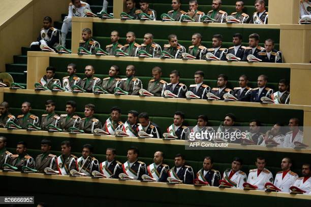 Members of Iran's Armed Forces attend President Hassan Rouhani's swearing in ceremony in Tehran on August 5 2017 Rouhani warned the US against...
