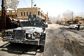 Members of Iraqi government forces patrol a street on June 27 2016 in western Fallujah 50 kilometres from the Iraqi capital Baghdad after Iraqi...