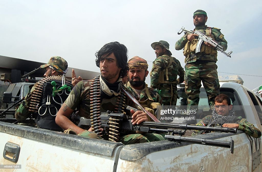 Members of Iraqi paramilitary Popular Mobilisation units which are dominated by Shiite militias take part in a military operation in the village of...