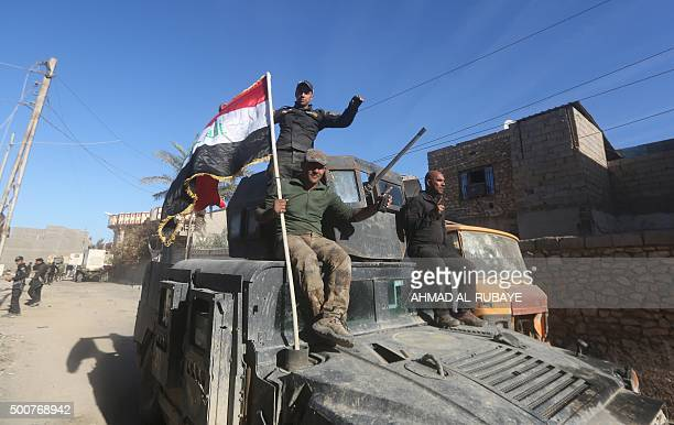 Members of Iraq's counterterrorism forces gesture as they enter the alTameem district of Ramadi a large city on the Euphrates 100 kilometres west of...